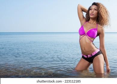 Beautiful young African American woman posing outdoor.