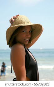 a beautiful young african american woman enjoys a day at the beach