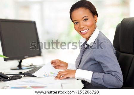 beautiful young african office worker in modern office