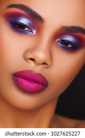 Beautiful young African woman with fashion makeup