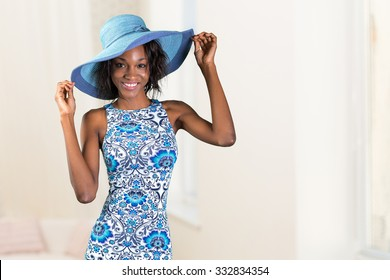 Beautiful young african woman in a hat