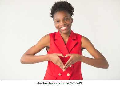 beautiful young african woman on white background in red suit with hand gesture