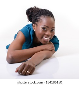 Beautiful young african woman smiling and looking at camera