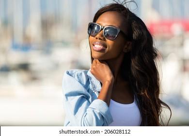 beautiful young african woman wearing sunglasses