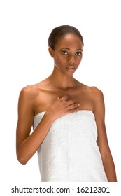 Beautiful young African-American woman with Slicked Back Hair wrapped in white bath towel preparing for sauna