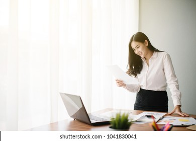 Beautiful young Asia woman working in office
