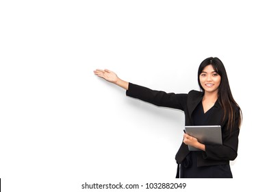 Beautiful young asian business woman presenting something on white board with copyspace