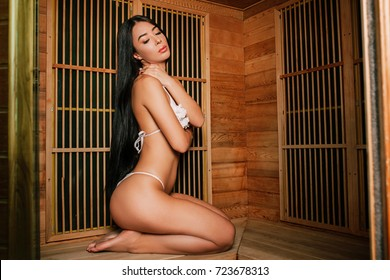 Beautiful young Asian girl in a bathing suit basks in an infrare