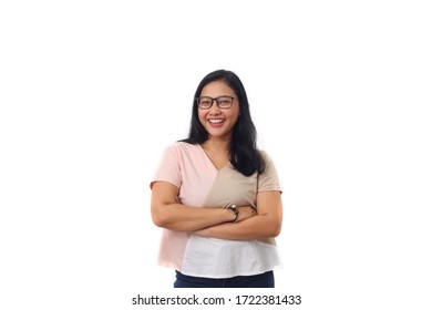 The beautiful young Asian girl smiled as she folded her arms and looked at camera. Isolated on white background