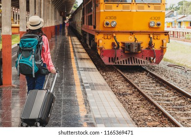 beautiful young asian girl traveling alone at train station
