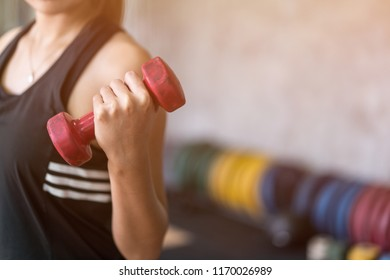 beautiful young asian gorlw working out at the gym for health and fitness