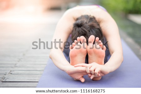 Beautiful young Asian happy woman doing yoga exercise. Healthy lifestyle and good wellness concepts