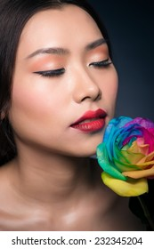 Beautiful young asian model with bright make-up and manicure. Closeup portrait of a serious asian lady with smoky eye makeup. Fashion Art Asian Girl Portrait