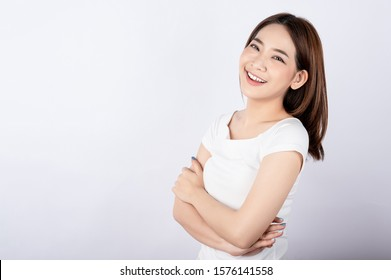 Beautiful young asian stand and pose with big smile happy beaming face in white background.