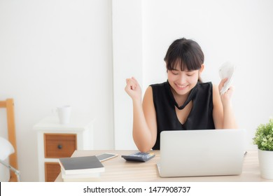 Beautiful young asian woman calculating finance household and writing notebook on desk, girl checking bill and success for saving expenses household with target, debt closure, business concept.