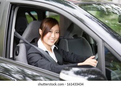 Beautiful young asian woman in a car