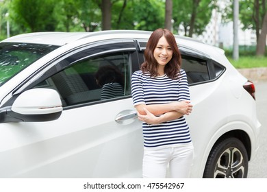 Beautiful young asian woman and car