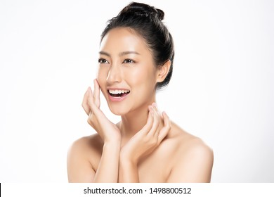 Beautiful Young Asian Woman with Clean Fresh Skin is touching her face, Facial treatment, Cosmetology, beauty and spa,