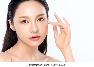 Beautiful Young Asian Woman with Clean Fresh Skin. Face care, Facial treatment, Cosmetology, beauty and healthy skin and cosmetic concept .woman beauty skin isolated on white background.