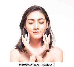 Beautiful young Asian  woman with clear fresh skin touch her own face . Facial treatment, skin cleanser, cosmetology, beauty and spa conceptual.