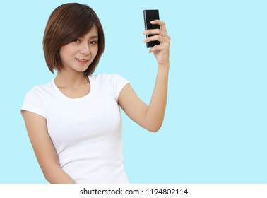beautiful young asian woman holding smart phone on hand