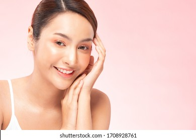 Beautiful Young Asian Woman Holding Hands smile feeling so happy and cheerful with healthy Clean and Fresh skin,isolated on PINK background,Beauty Cosmetology and spa treatment Concept