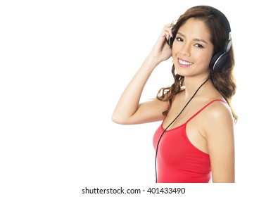 beautiful young asian woman listening to music with headphones isolated on white
