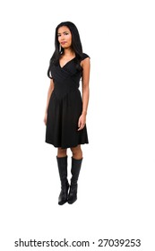 Beautiful young Asian woman with long black hair dressed in a nice little black dress