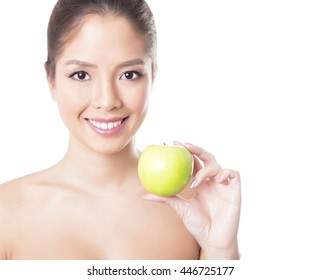beautiful young asian woman with long hair, flawless skin and perfect make-up, holding apple