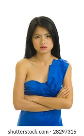 beautiful young asian woman with nice blue dress doesn't seem to be very happy - isolated on white