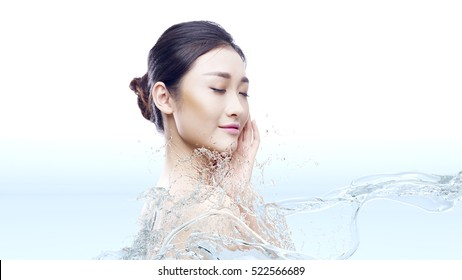 beautiful young asian woman with perfect skin in splashes of water