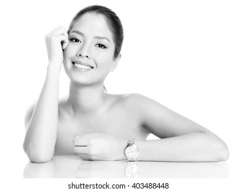 beautiful young asian woman posing with wrist watch, isolated on white