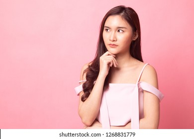 Beautiful young Asian woman say no on pink background