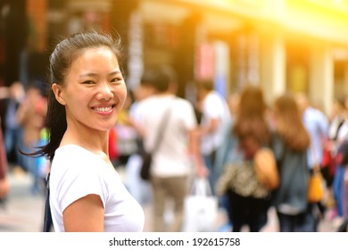 beautiful young asian woman smile on shopping street