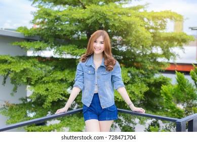 Beautiful young asian woman smiling pretty