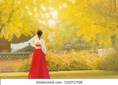 Beautiful Young asian woman traveler  in Korean national dress or Hanbok traveling Autumn at Gyeongbokgung palace in Seoul,South Korea