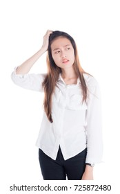 Beautiful young asian woman with unhappy face standing over white background