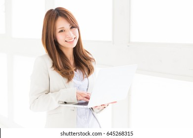 Beautiful young asian woman using laptop