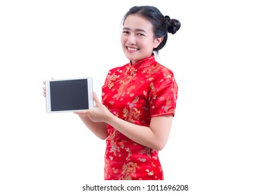 Beautiful Young asian woman wear chinese dress traditional cheongsam or qipao. Hand holding blank screen digital tablet. isolated on white background, Concept buying digital online, technology.