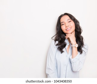 beautiful young asian woman wearing wrist watch and posing on grey background with copy space