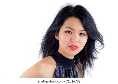 Beautiful Young Asian Woman Wearing A Cocktail Dress Isolated On A White Background