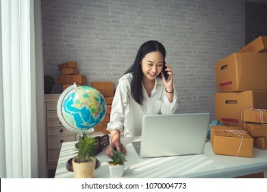 Beautiful Young Asian Woman Working at home, Young Owner Woman Start up for Business Online, SME, Delivery Project, Woman with Online Business or SME Concept.