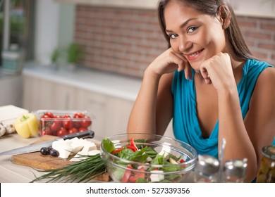 beautiful young Asian women in the kitchen