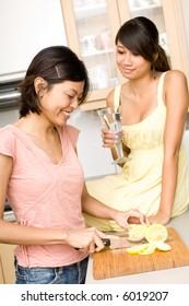 A beautiful young asian women preparing lemons in the kitchen