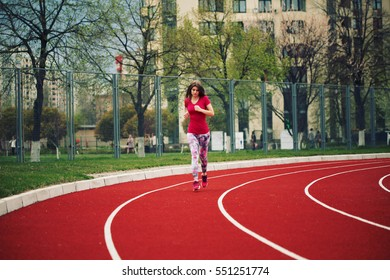 Beautiful young athlete woman working out. Fitness concept. Outdoors, lifestyle