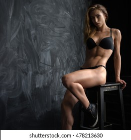 Beautiful young athletic girl in underwear with Spanish looks on a dark background