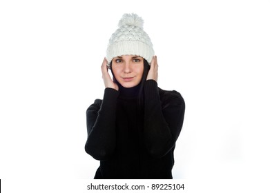a beautiful young attractive charming girl in a black jacket and white winter hat, isolated over white