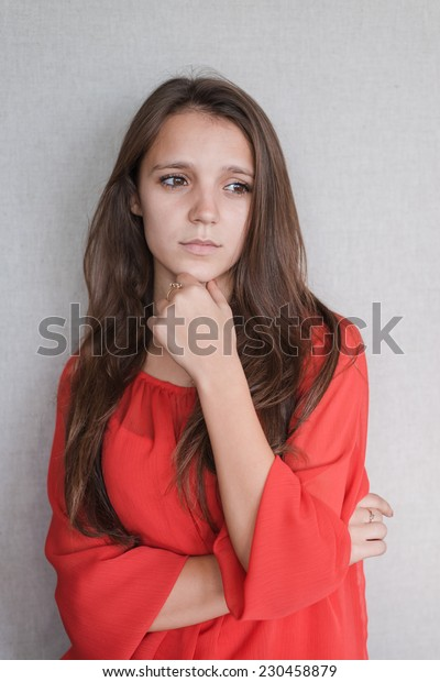 Beautiful young attractive woman  holding her chin