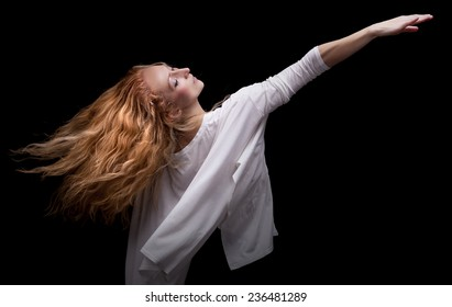 Beautiful young ballerina dances