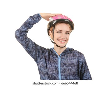 Beautiful young bicycle rider with helmet on white background